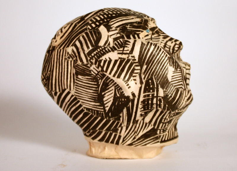 Head # 1978 (from a series of heads) / clay, vintage paper (Village Voice), glass / Vienna 2011